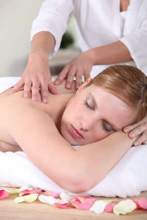 Woman enjoying a back massage Stock Photo - 13862009