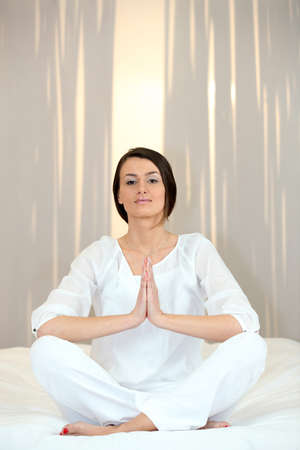 Young woman doing yoga Stock Photo - 13867040