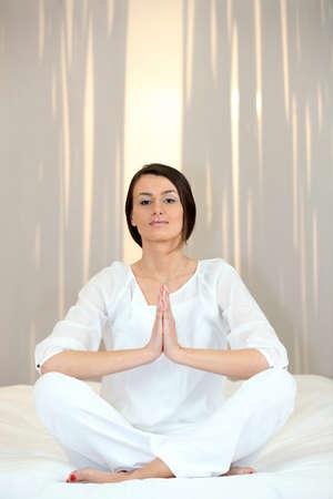 Young woman doing yoga Stock Photo - 13867040