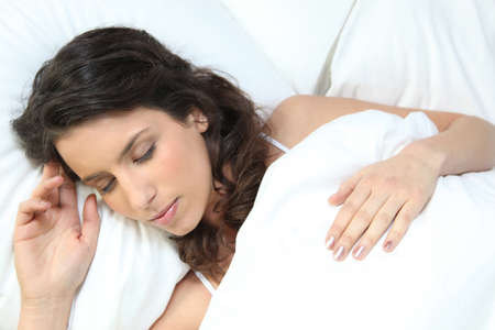 Brunette woman sleeping photo