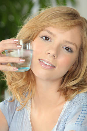 adequate: Young woman with glass of water