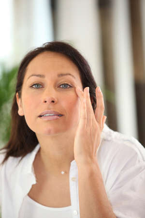 Woman applying cream photo