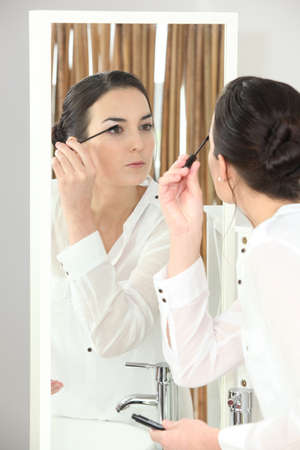 Woman applying mascara Stock Photo - 13869237