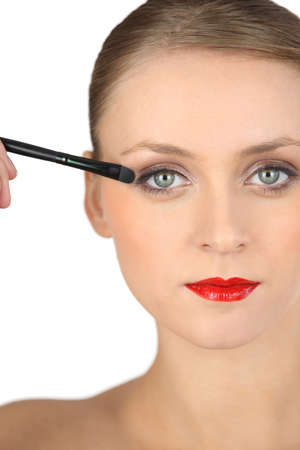 prettify: Sophisticated girl making-up Stock Photo