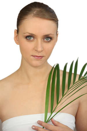 Woman holding a fern photo