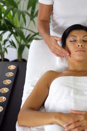 Woman having a face massage photo
