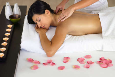 Woman enjoying a back massage photo