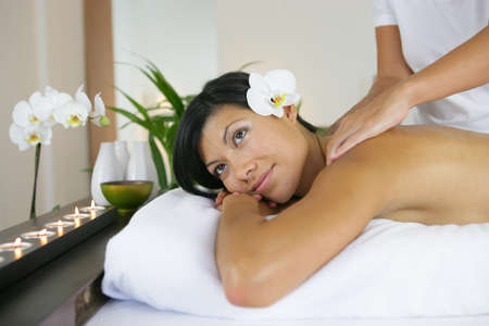 Woman receiving professional massage photo