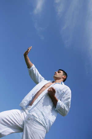 Man practicing judo against a blue sky Stock Photo - 13875592