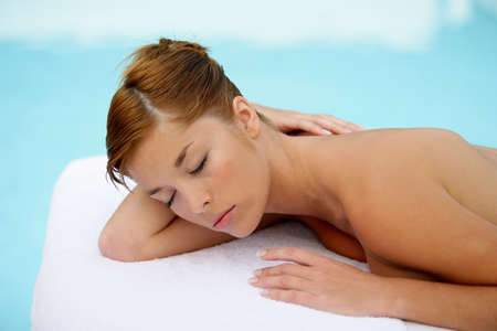 Woman relaxing on massage table photo