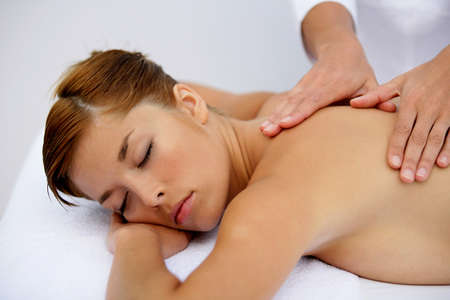Woman having a soothing back massage Stock Photo - 13876440