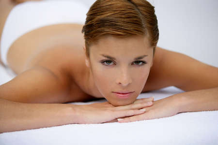 Young woman lying on massage table Stock Photo - 13875799