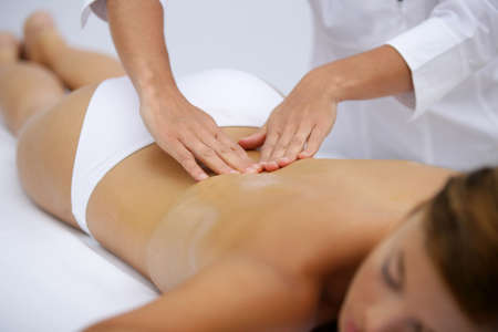 Woman receiving back massage photo
