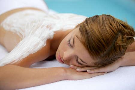woman having back massage photo