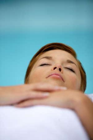 siesta: Woman laid down relaxing