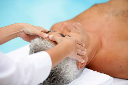 greying: A man getting a massage