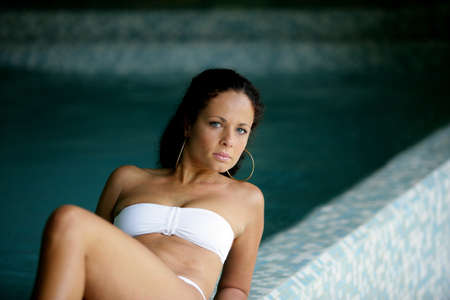 Brunette laying poolside Stock Photo - 13875549