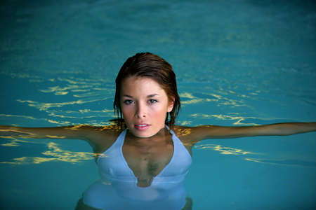 Woman swimming in a pool photo
