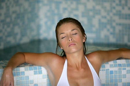woman relaxing in a spa center photo