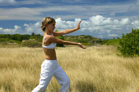 woman doing exercises in a field photo