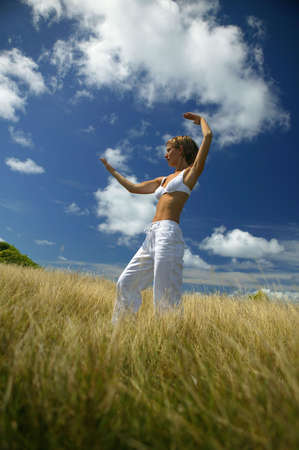 Woman doing yoga in the countryside photo