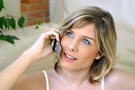 Young woman talking on her mobile phone photo