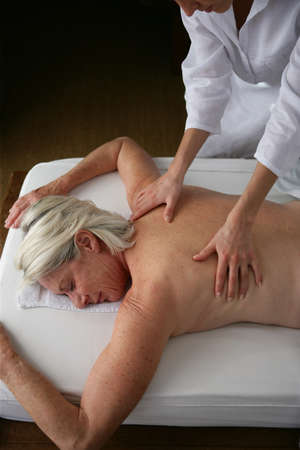 Senior woman having a back massage photo