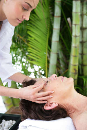 massaged: mature woman being massaged in exotic setting