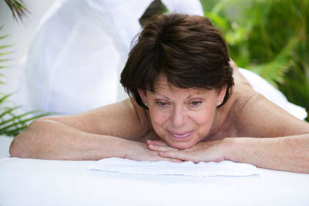 Mature woman having a massage photo