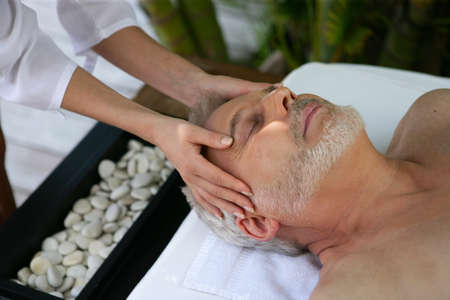 Man receiving head massage at day spa photo
