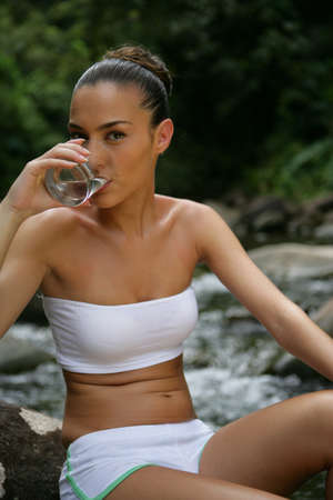 beautiful woman drinking spring water Stock Photo - 13875832