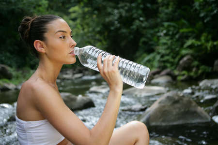 woman drinking fresh spring water Stock Photo - 13875661