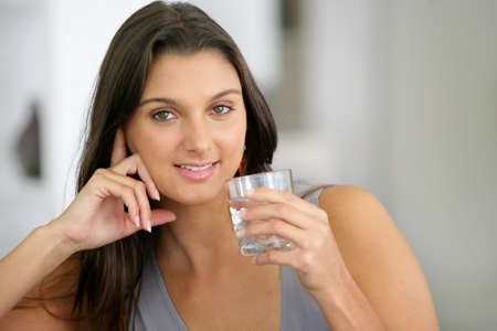 girl drinking water: woman drinking water