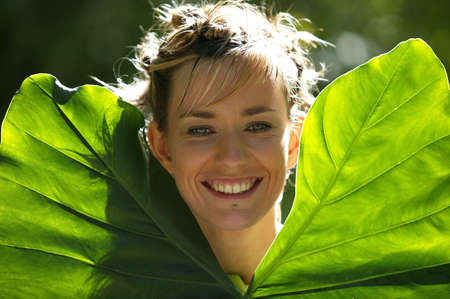 Woman holding big leaves Stock Photo - 13861811