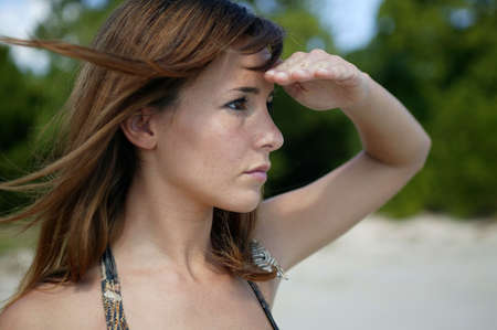 Woman looking into the distance photo