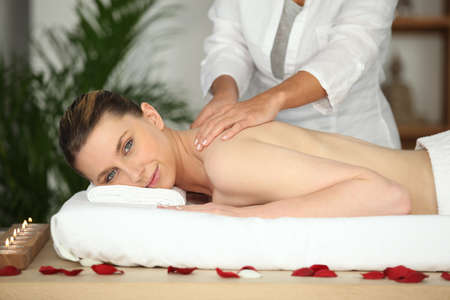 Girl having back massage in beauty parlor photo