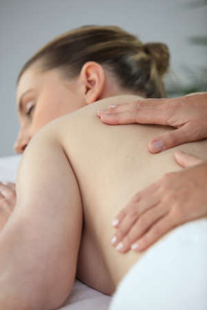 Woman having a back massage Stock Photo - 13875709