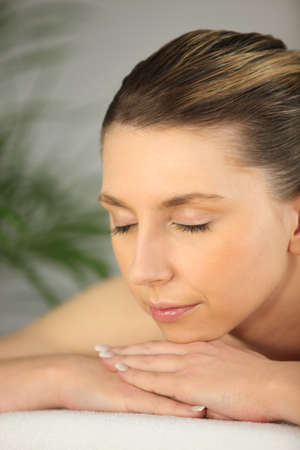 sanitarium: woman relaxing on the massage table Stock Photo