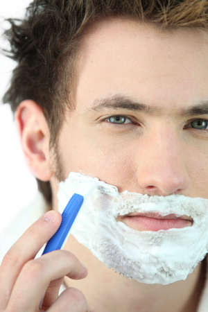 shaving blade: Man shaving