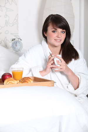 parsimony: Woman with breakfast in bed