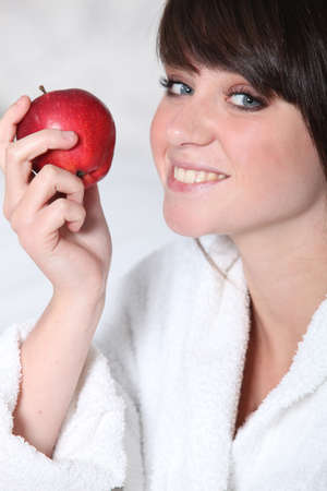 Young woman with a red apple photo