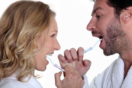 Couple brushing teeth Stock Photo - 13875296