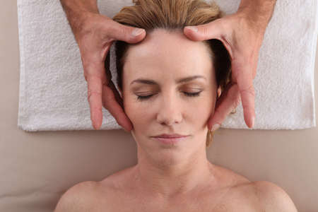Woman having a head massage photo