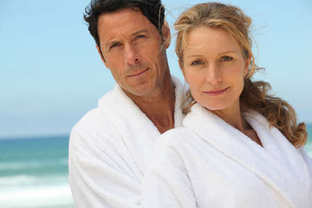 Middle-aged couple in bathrobe photo