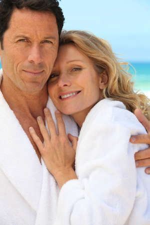 robes: Couple in toweling robes by the ocean