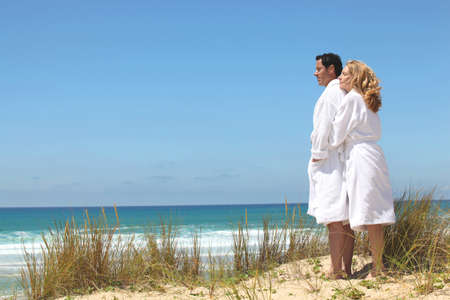 robes: couple in robes on the beach