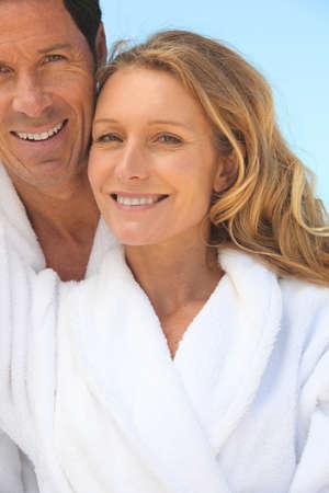couple on vacation wearing bathrobes photo