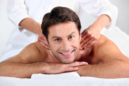 Man enjoying a back massage photo