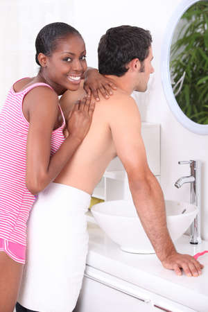 black man white woman: Woman giving a man a massage