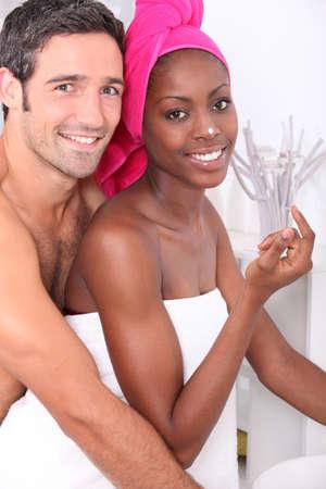 bathroom women: Romantic couple in bath robes